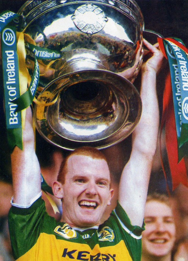 Liam Hassett, 1997 Kerry Captain, holds the Sam Maguire Cup aloft
