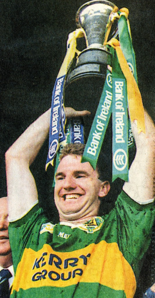 Mike Hassett, 1997 Kerry Captain, lifts the Munster Senior Football Championship Cup aloft