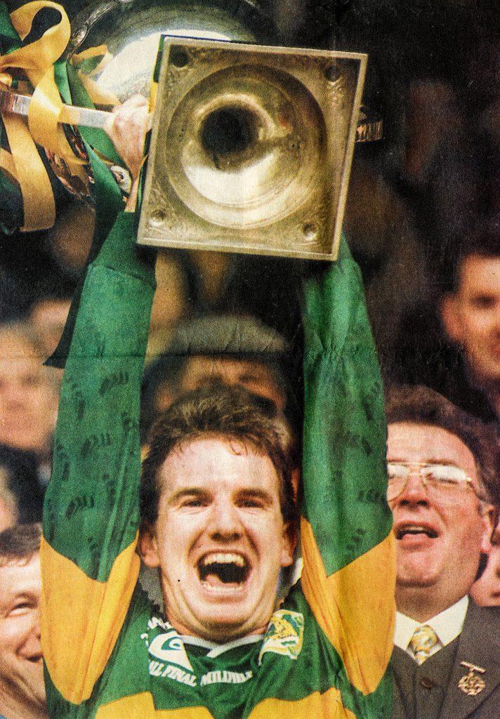 Mike Hassett, 1997 Kerry Senior Football Captain, lifts the NFL Trophy aloft