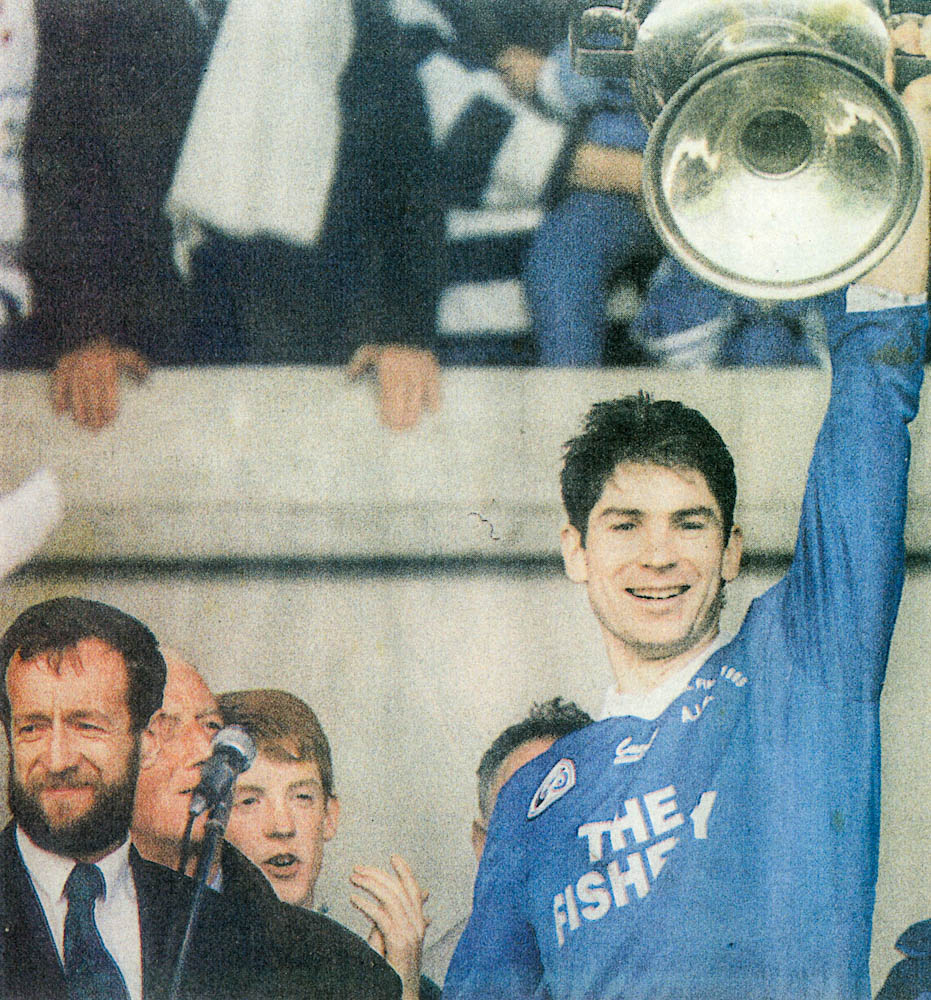 Gerard Murphy (capt.) 1995 received the Bishop Moynihan Cup from Sean Kelly, Chairman Kerry Co. Board.