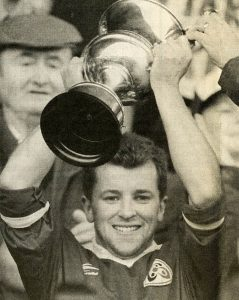 Mark O Connor (capt.) 1996 proudly holds the Munster Club Championship trophy aloft.