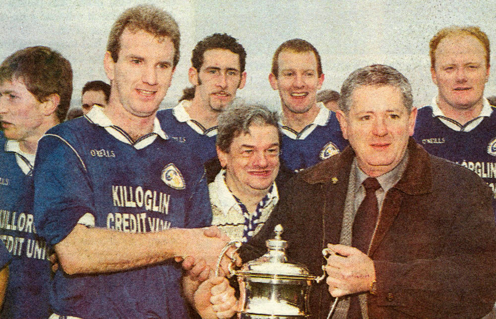 Mike Hassett (capt.) received the O Connor Cup from John Dowling, Chairman Mid-Kerry Board (1999)
