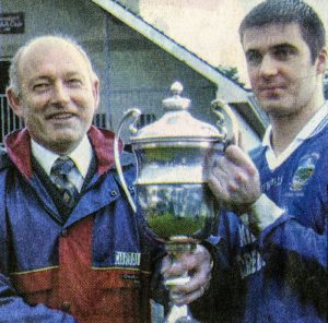 Pa O Sullivan (captain) received the O Connor Cup from John Twiss, Chairman Mid-Kerry Board.