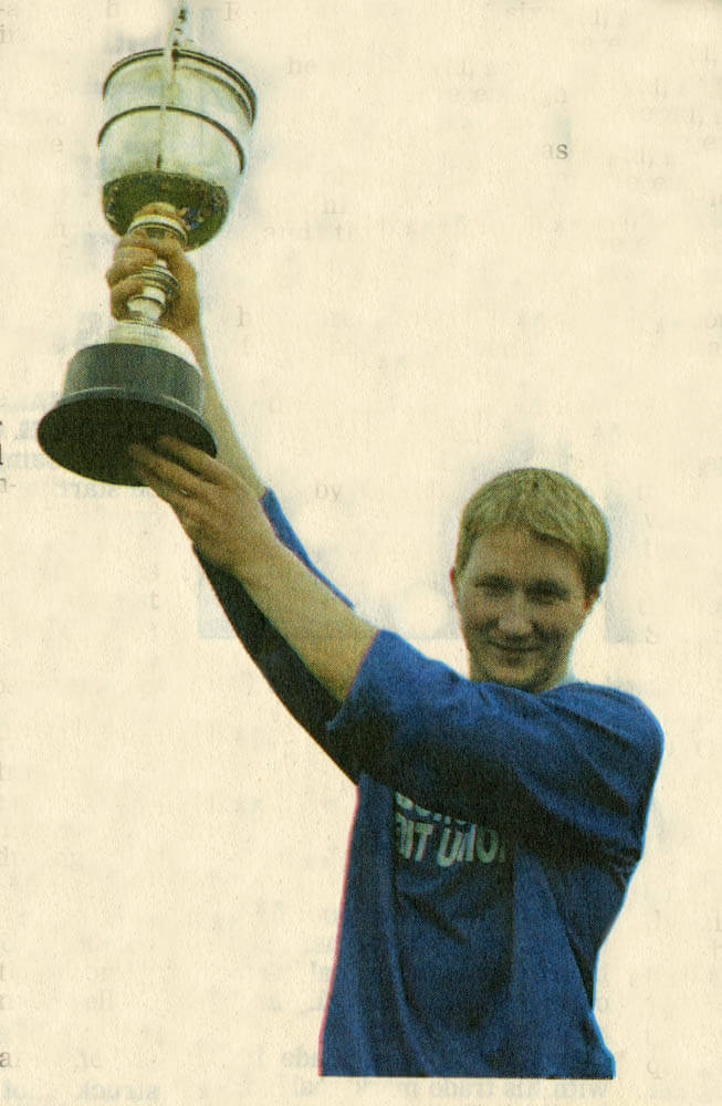 Mike Frank Russell (captain) raised the O Connor Cup aloft.