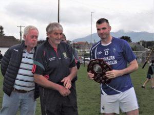 Eamonn Carey accepts trophy