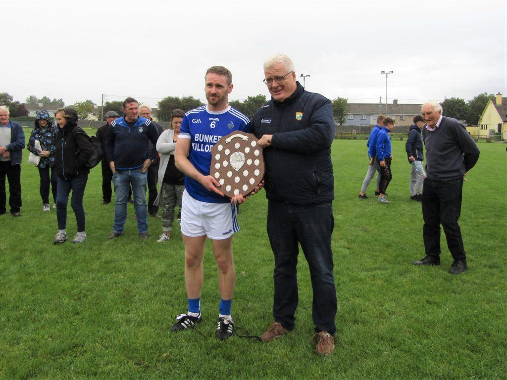 Kieran accepts trophy